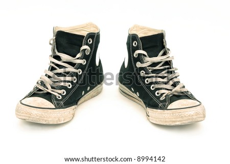 Old canvas sneakers, isolated - stock photo