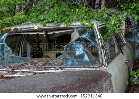 Old car at a junkyard at Bragas in Sweden - stock photo