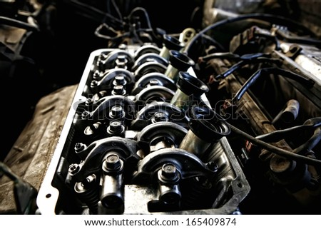 old car engine in oil inside view isolated over white - stock photo