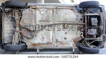 old car flipped over - stock photo