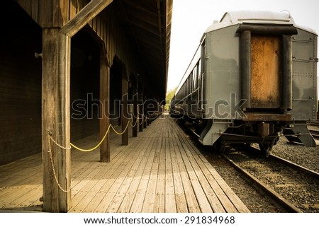 Old car on wooden station