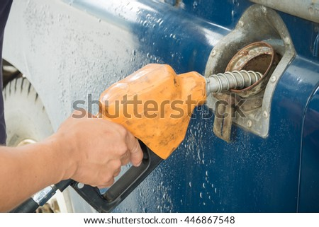 Old car refueling on a gas station. - stock photo