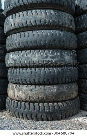 Old car tires awaiting recycling.