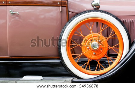 Old car with orange tire profile