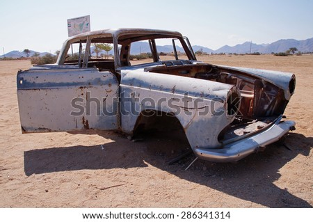 Old car wreck in the small settlement of Solitaire in Namibia