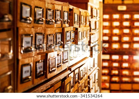 old card index with cards in the library with the glowing boxs - stock photo