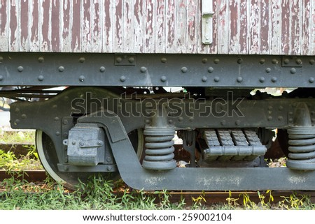 Old cargo and rusty train wheels on the railway track - stock photo