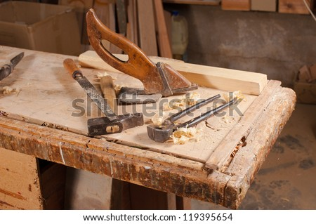 Old carpentry tools on a work bench - stock photo