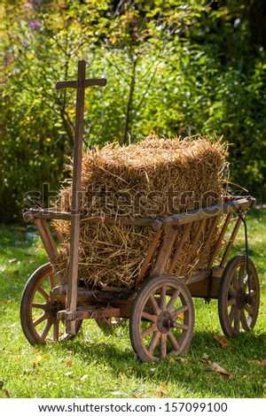 Old carriage cart with straw - stock photo