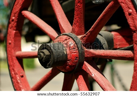 Old carriage wheel, close up - stock photo