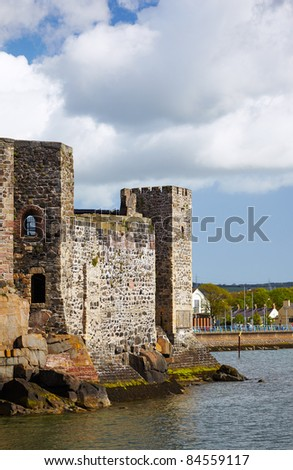 Old Carrickfergus Castle on the northern shore of Belfast Lough in Northern Ireland - stock photo