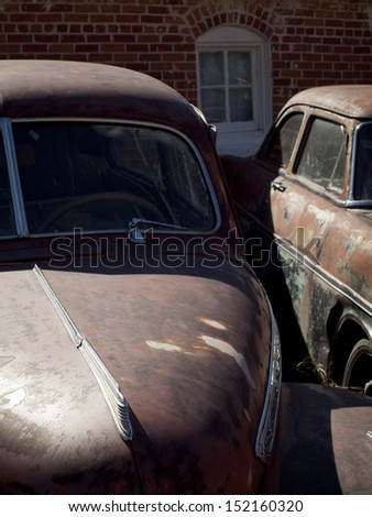 Old cars at the garage in Ramah, Colorado. - stock photo