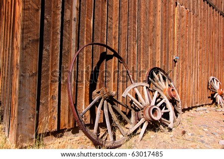 Old cart parts in a Ghost town near Cody, Wyoming - stock photo