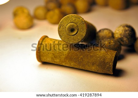 Old Cartridges 1875 near some shrapnel - stock photo