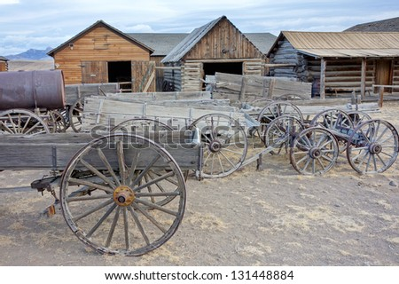 Old carts in a Ghost town near Cody, Wyoming, United States - stock photo