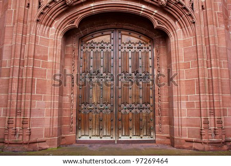 Old carved entrance door to Cathedral - stock photo