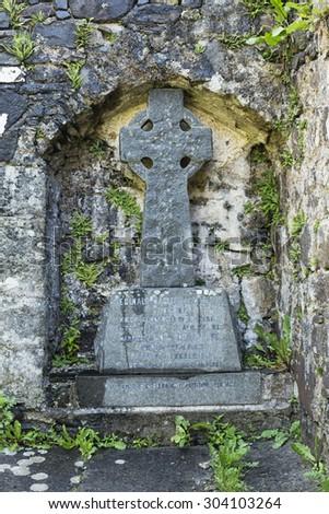 Old carved stone Celtic cross in cemetery, UK - stock photo