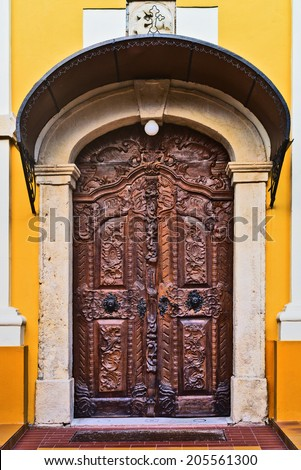 Old carved wooden church door. Religious abstract. - stock photo