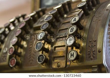 Old cash register close-up. - stock photo