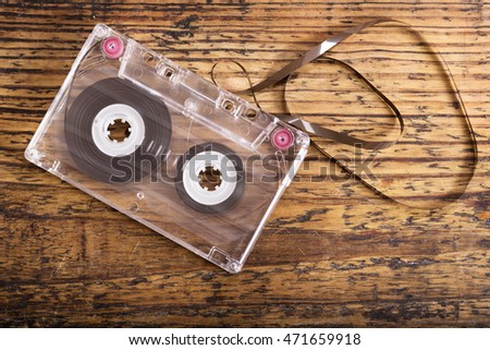 old cassette tape on wooden background