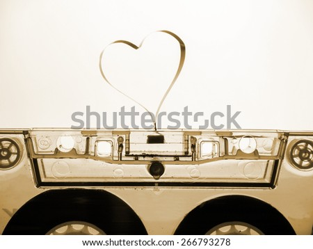 Old cassette tape with Heart Shape - stock photo