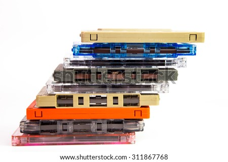 Old cassette tapes on white background