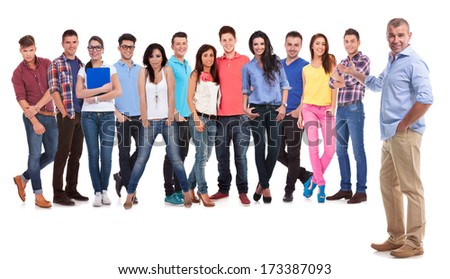 old casual man presenting his young team of people on white background