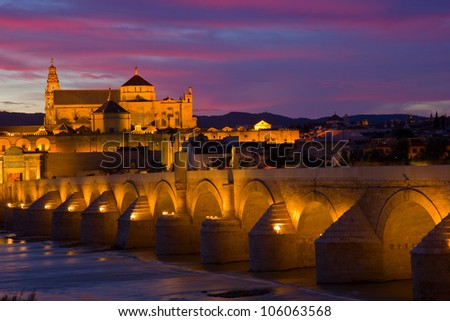 old cathedral and roman bridge at sunset, Cordoba, Andalusia, Spain - stock photo