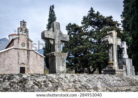 Old catholic church with crosses - stock photo
