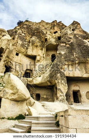 Old cave monastery in Cavusin, Cappadocia, Turkey - stock photo