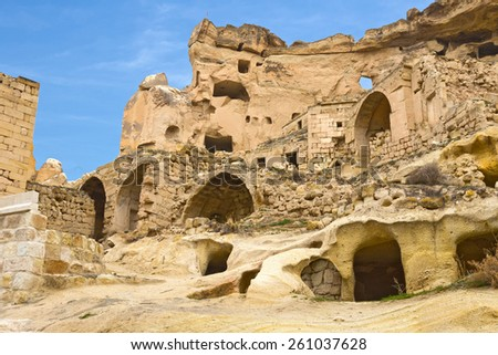 Old cave town in Cavusin, Cappadocia, Turkey - stock photo