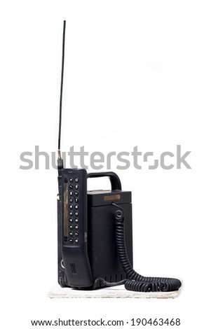 Old cellular mobile phone isolated on white background. - stock photo
