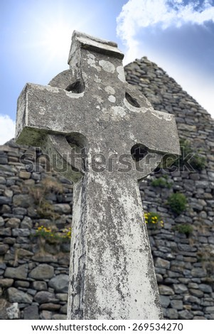 old celtic cross head stone from a grave yard in county kerry ireland - stock photo