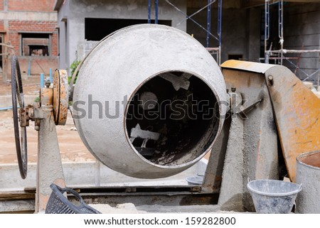 old cement mixer at the construction site  - stock photo