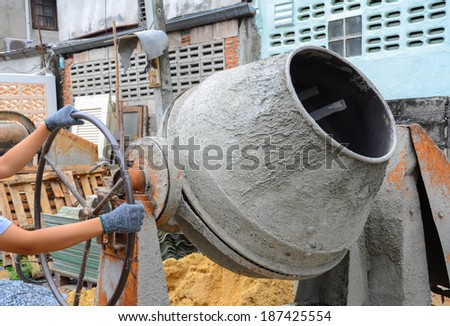 Old cement mixer used in construction. - stock photo