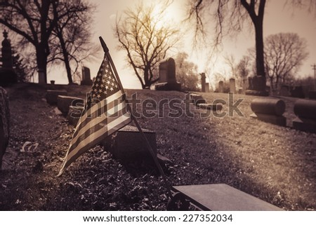 Old cemetery - vintage look with american flag - stock photo