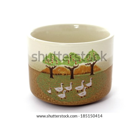 old ceramic cup isolated on white background - stock photo