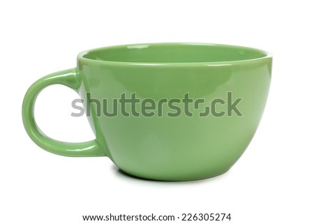 Old ceramic cup on white background