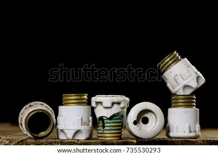 stock photo old ceramic fuse holders old electrical accessories wooden table black background 735530293 ceramic fuse stock images, royalty free images & vectors old ceramic fuse box at gsmx.co