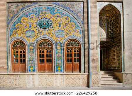 Old ceramic tiles on the wall of the royal palace Golestan in Tehran, Iran. Golestan Palace is the oldest groups of buildings in Teheran, became the seat of government of the Qajar family in 1779. - stock photo