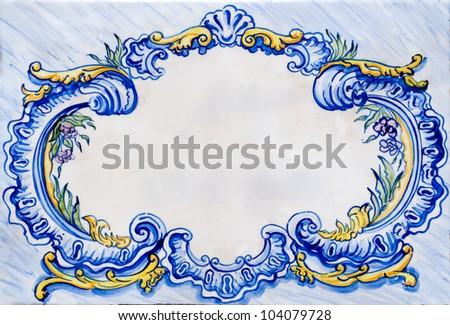 Old ceramic white, blue and yellow glazed tile frame. - stock photo
