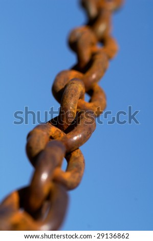 Old chain going to the sky - stock photo