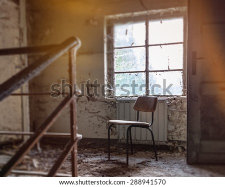 old chair by the window - stock photo