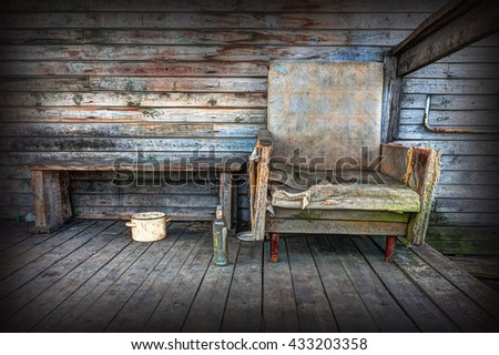 Old chair on the background of wooden wall. - stock photo