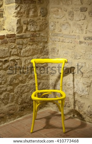 old chair over the brick wall