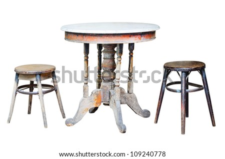 Old chairs and old table on white background. - stock photo