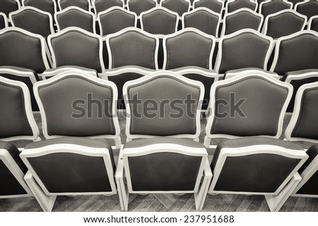 old chairs at a theater - stock photo