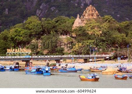 Old cham towers, bridge and boats in Nha Trang, Vietnam