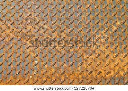 old checker plate floor surface texture steel grip metal grating - stock photo