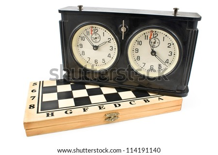 Old chess clock on chessboard isolated on white - stock photo